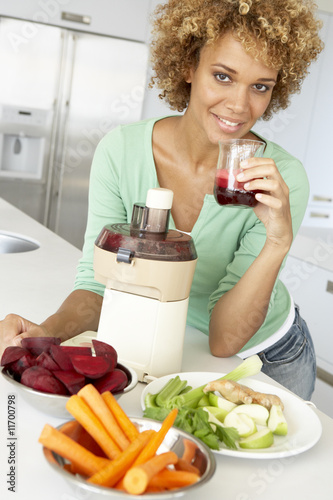 Mid Adult Woman Making Fresh Vegetable Juice