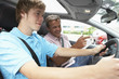 Teenage Boy Taking A Driving Lesson - 11702756