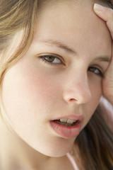 Portrait Of Teenage Girl Looking Frustrated
