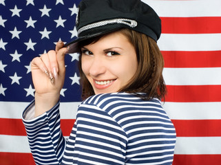 coquettish sailor standing near the American flag