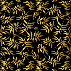 Black background with an ornament from golden leaves