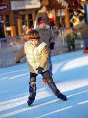 child learning ice skating