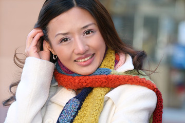 Winter Theme - Beautiful Asian Girl in White Coat and Colorful K