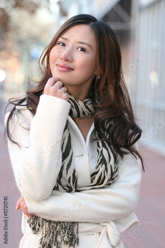 Winter Theme - Beautiful Asian Girl in White Coat and Scarf Smil