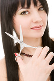 Lovely brunette with scissors of the hairdresser poster