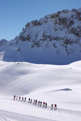 group of people in high snow mountains