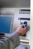 hand inserting card into cash dispense poster