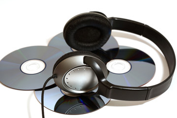 stereo head phones with CD's on a white background