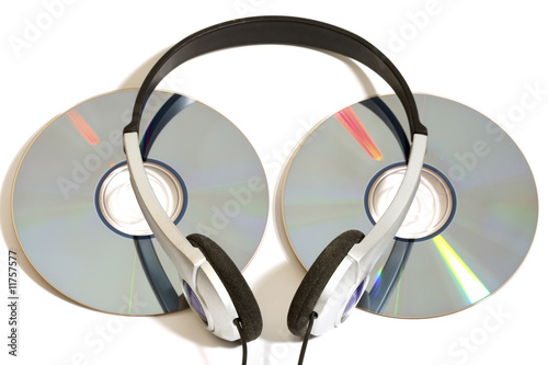 stereo head phones with two CD's on white background