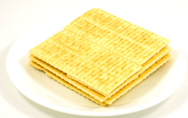 Gourmet crackers on dish.