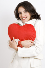 Young Woman holds a big red heart
