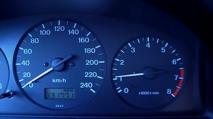 Tachometre and speedometer on the automobile panel