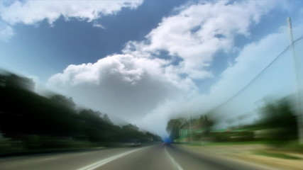 Driving and time lapse clouds