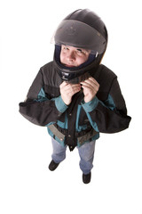 man in motorcycle jacket buttoning helmet.