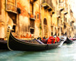 Traditional Venice gandola ride (shallow DoF, focus on gandola)