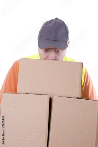 delivery man keeping cardboard boxes