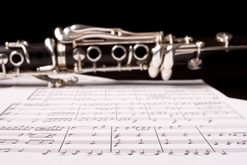 Clarinet isolated over sheet music