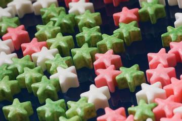 Sugar colour stars on glass.