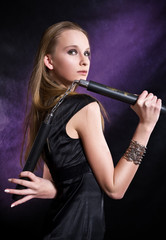 girl posing with nunchaku
