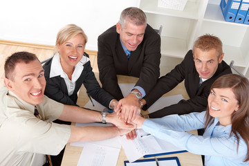Business group hands put toghether