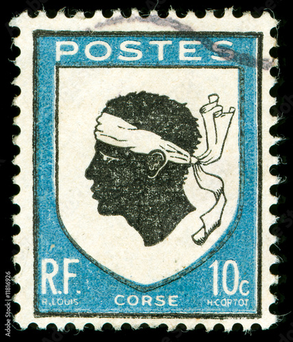 vintage postage stamp with corsica national emblem
