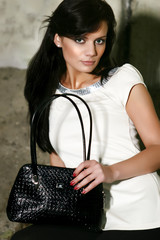 brown haired pretty woman with handbag and green eyes