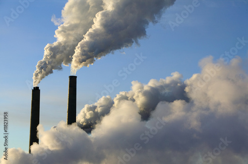 steam rise from smokestacks at an electrical generating plant