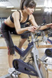 working out in the gym on a bike