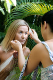Model having make-up retouched by stylist. poster