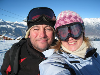Portrait of happy young couple on a winter skiing holiday