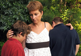Mother comforting sons - death or divorce
