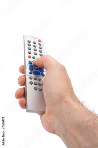 Hand holding a TV remote control isolated on white.