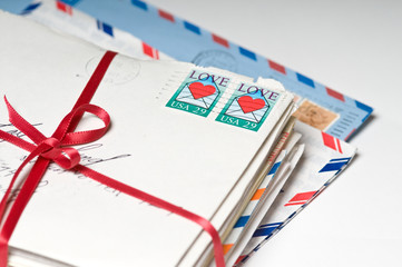 Love Letters tied with a Red Ribbon
