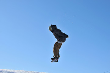 girl snowboarder in the air