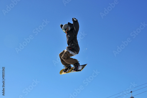 girl snowboarder on a high jump