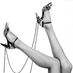 Woman legs with beads
