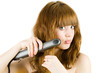 Blonde using hair straightener