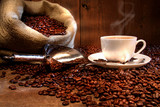 Coffee cup with burlap sack of roasted beans - Fine Art prints