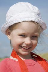 Smiling little girl on the sea coast