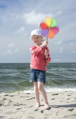 Cheerful little girl with pinwheel II
