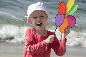 Shouting girl with pinwheel