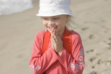 Smiling cheerful girl on the seacoast II