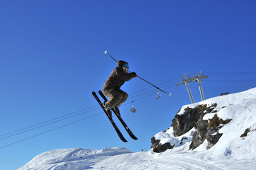 Skier performing a full turn in a jump
