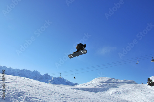 A snow-boarder performing aerial skiing