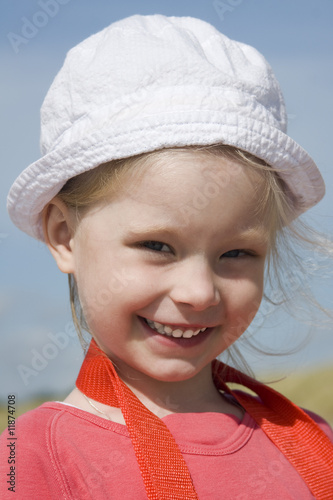 Smiling little girl on the sea coast