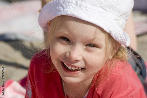 Smiling cheerful girl on the beach