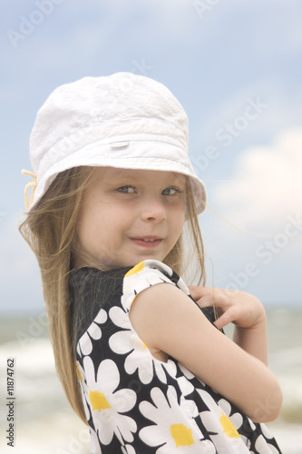 Cheerful girl in beautiful dress and hat II