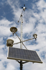 Solar battery and meteorological devices on sky background