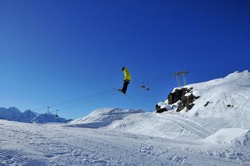 Aerial skiing: skier in yellow jacket
