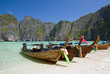Quadro Longtail boats in the famous Maya bay of Phi-phi Leh island